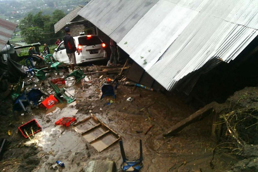 Villagers attempting to salvage their belongings after the landslide in Kintamani, Bali province, on Feb 10, 2017.