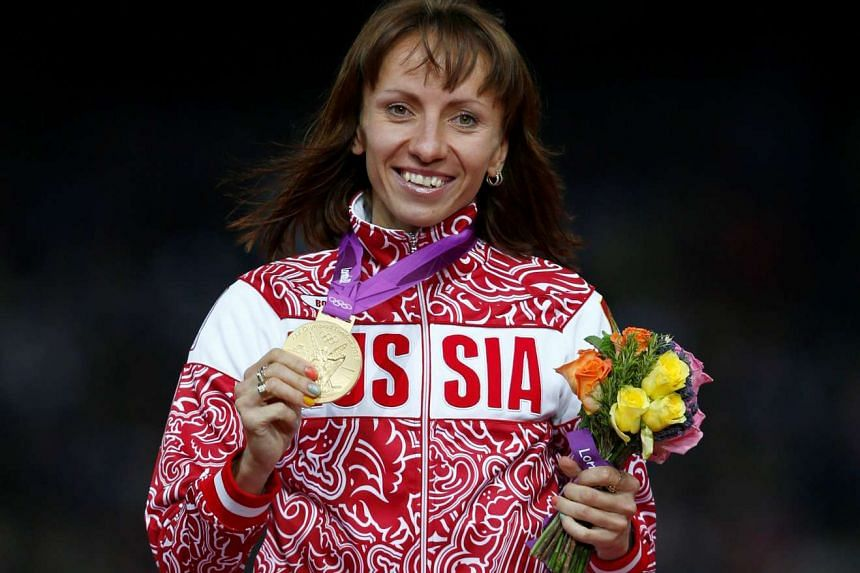 Russia's Mariya Savinova holds her gold medal during the women's 800m victory ceremony at the London 2012 Olympic Games at the Olympic Stadium, Britain on Aug 11, 2012.