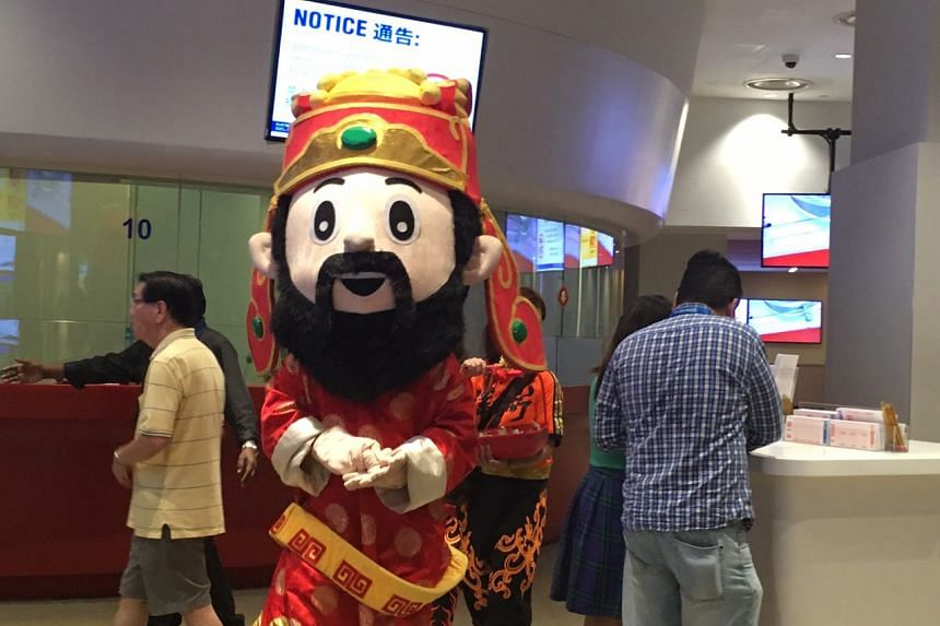 A 'Cai Shen Ye', or God of Fortune, mascot was seen at the Singapore Pools building at 210 Middle Road, about 40 minutes before the $12 million Toto Hongbao draw.