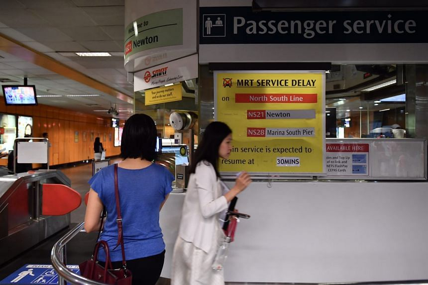 A sign at Newton MRT station, seen at about 8.45am, informing commuters about the delay.