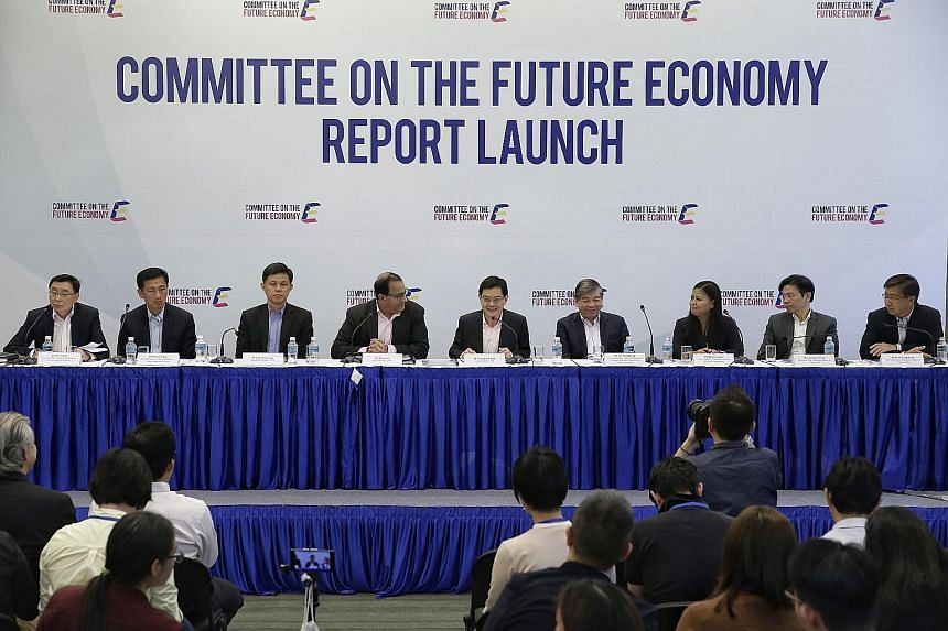 From left: Mr Bill Chang, co-chairman, sub-committee on future jobs and skills; Mr Ong Ye Kung, co-chairman, sub-committee on future jobs and skills; Mr Chan Chun Sing, deputy chairman, Committee on the Future Economy; Mr S. Iswaran, co-chairman, Com
