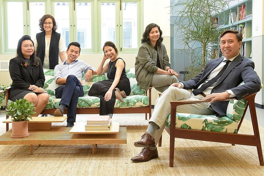 Mr Ing (far right) with staff of The Lo & Behold Group (from left) Ms Wong, Ms Deborah Theseira, Mr Allan Shieh, Ms Tania Chan and Ms Hamazia Kasban. Ms Wong, now the director of operations systems, tapped the firm's training budget to upgrade hersel