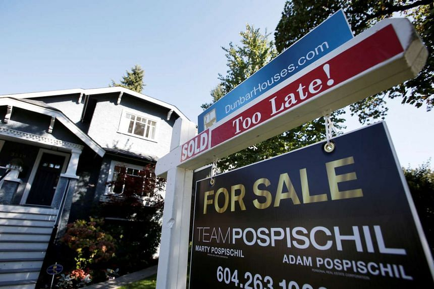 A real estate for sale sign is pictured in front of a home in Vancouver, on Sept 22, 2016.