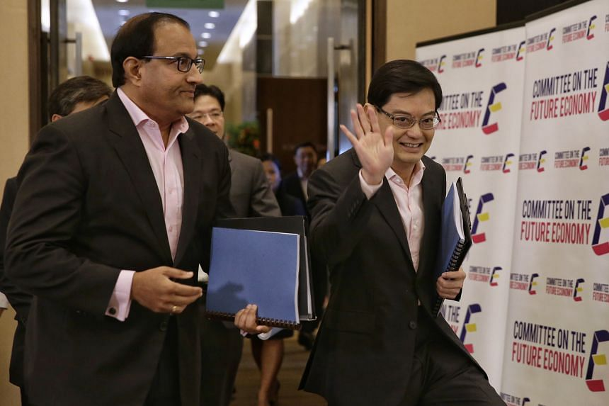 Finance Minister Heng Swee Keat and Minister for Trade and Industry (Industry) S. Iswaran, co-chairmen of the Committee on the Future Economy, arriving for the release of the CFE report yesterday.