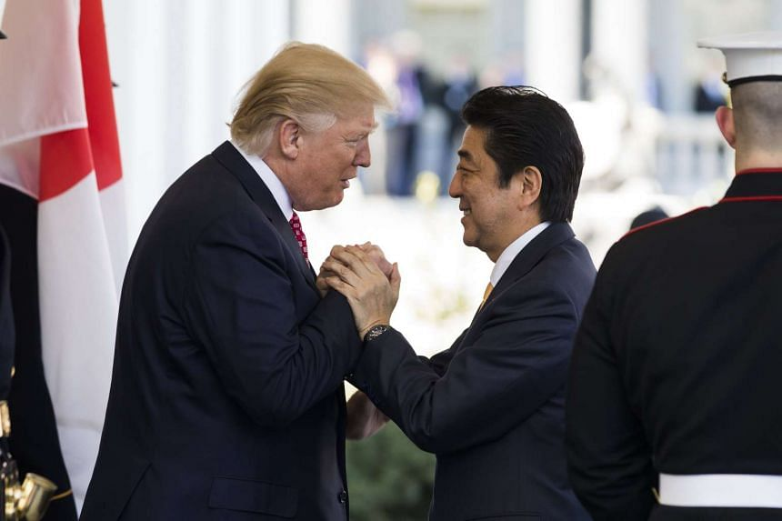 US President Donald J. Trump greets Japanese Prime Minister Shinzo Abe prior to their meeting in the Oval Office of the White House in Washington, DC, USA, on Feb 10, 2017.