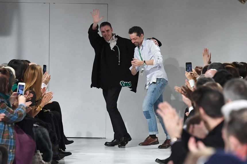 Designers Raf Simons (left) and Pieter Mulier walk the runway at the Calvin Klein show at New York Fashion Week on Feb 10, 2017.