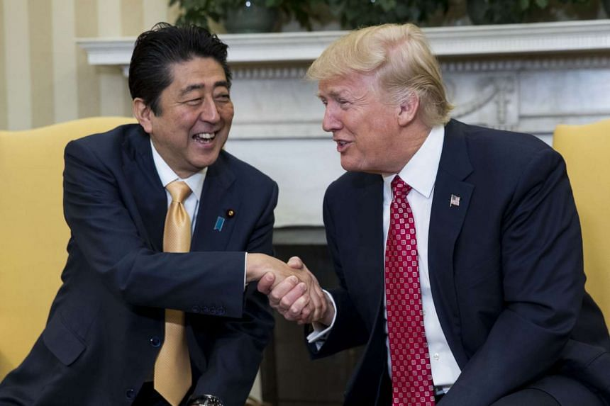Trump and Abe in the Oval Office of the White House, in Washington, Feb 10, 2017.