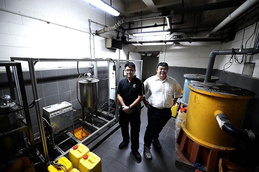 Mr Lim (right) with Alpha Biofuels' chief operations officer Jack Ling. The firm's recycling facility at Raffles City Shopping Centre converts used cooking oil into biofuel to power vehicles, generators and forklifts.