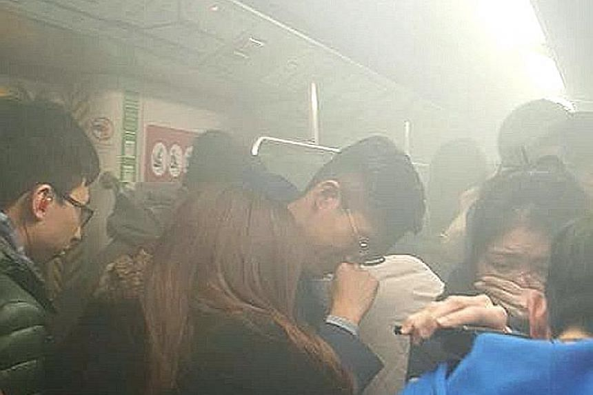 Smoke in one compartment quickly filled the entire MTR train, an eyewitness said. The alleged perpetrator tried to hurl a lit Molotov cocktail on board the packed train when it was about to reach Tsim Sha Tsui platform, but caught fire himself.