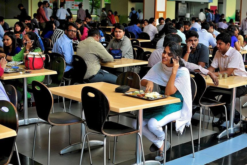 Workers in the cafeteria of Infosys' headquarters in Bangalore. Firms such as Infosys send their engineers to the US for projects under the work visa.