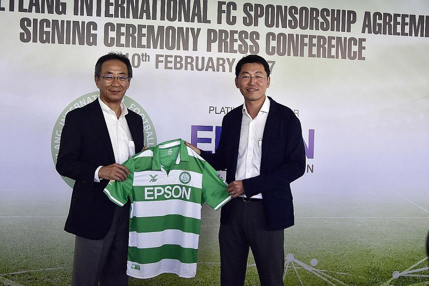 In a gesture to reaffirm their partnership, S-League football club Geylang International's chairman Ben Teng (right) presented an Eagles jersey to Toshimitsu Tanaka, Epson Singapore's managing director (South-east Asia) yesterday at a signing ceremon