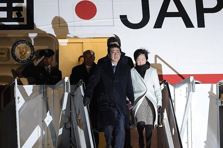 Mr Abe and his wife Akie Matsuzaki arriving at Andrews Air Force Base in Maryland, outside Washington, on Thursday. Ties between Japan and the US have been clouded by uncertainty due to trade issues.