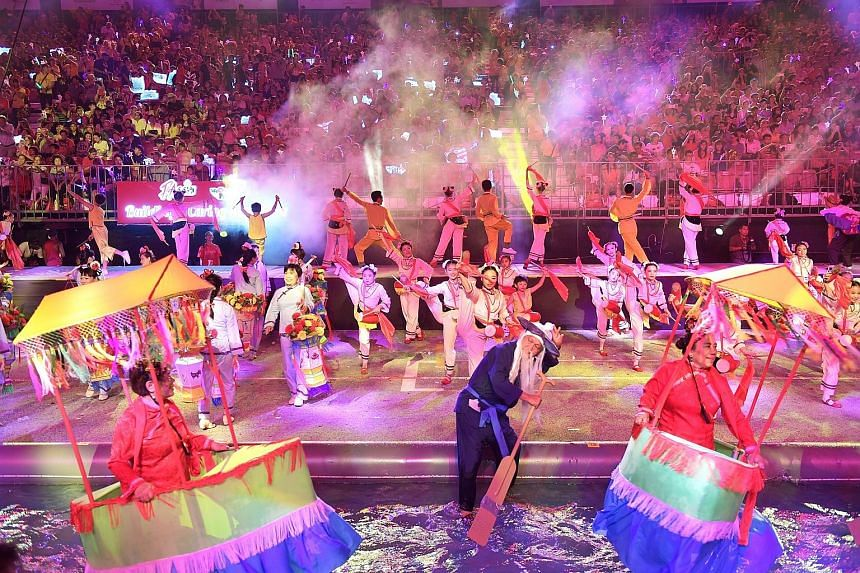 Performers splashed through a 360m by 3m waterway that is one of the features at this year's Chingay street parade, which is themed Soundwaves Chingay, WeCare Singapore. The three-hour spectacle last night at the F1 pit building featured multicoloure