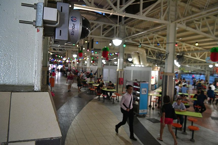 A police camera at a hawker centre in Ang Mo Kio Avenue 6. The police installed 51 new cameras at Ang Mo Kio Town Centre in June last year, under the PolCam 2.0 programme, as part of the field-testing.