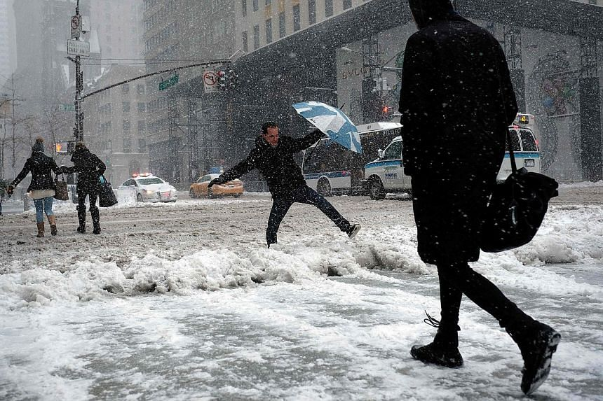 Roads and pavements in New York were left dangerously slick on Thursday as the north-eastern US was pummelled by the fiercest snowstorm of the winter. At least two deaths were blamed on the storm, which led to thousands of flights being cancelled and