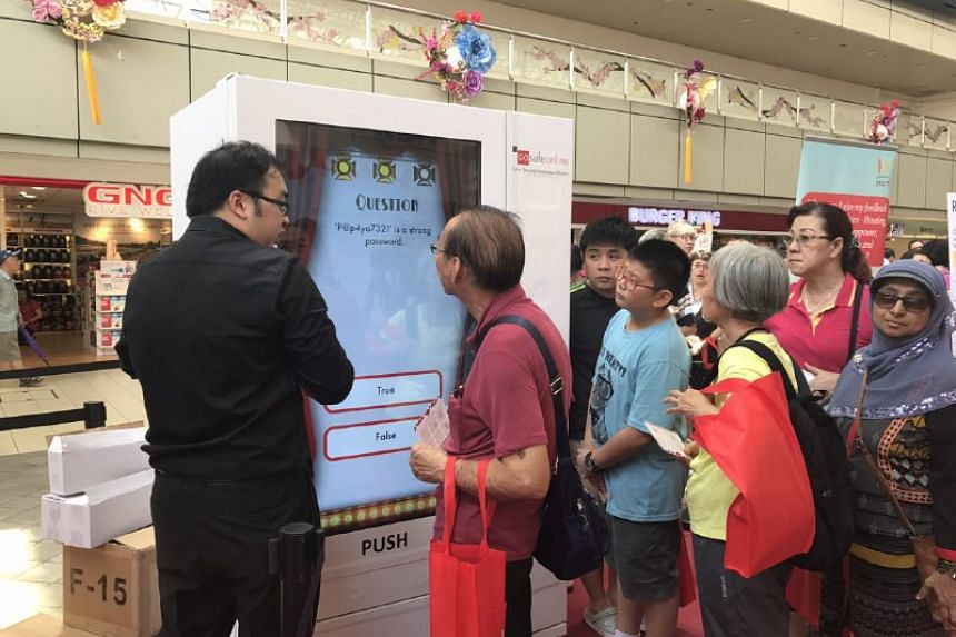 Visitors to the cyber security awareness roadshow at Toa Payoh Hub atrium learning more about the importance of keeping their online activity safe on Feb 11, 2017.