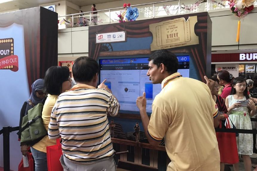 Visitors to the cyber security awareness roadshow at Toa Payoh Hub atrium learning more about the importance of keeping their online activity safe on Feb 11, 2017. ST PHOTO:  AUDREY TAN