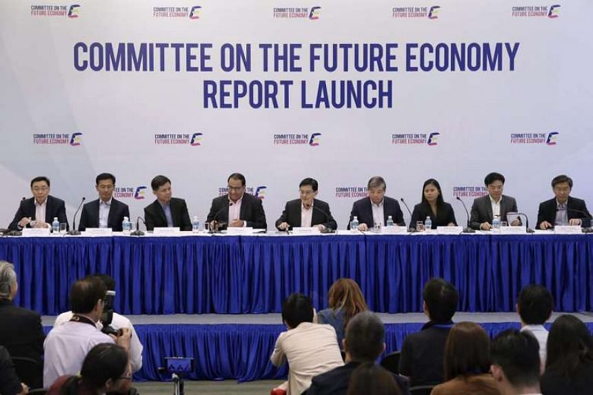 The Committee on the Future Economy, co-chaired by Finance Minister Heng Swee Keat (centre) and Minister for Trade and Industry (Industry) S Iswaran (fourth from left), releases its report on Feb 9, 2017.