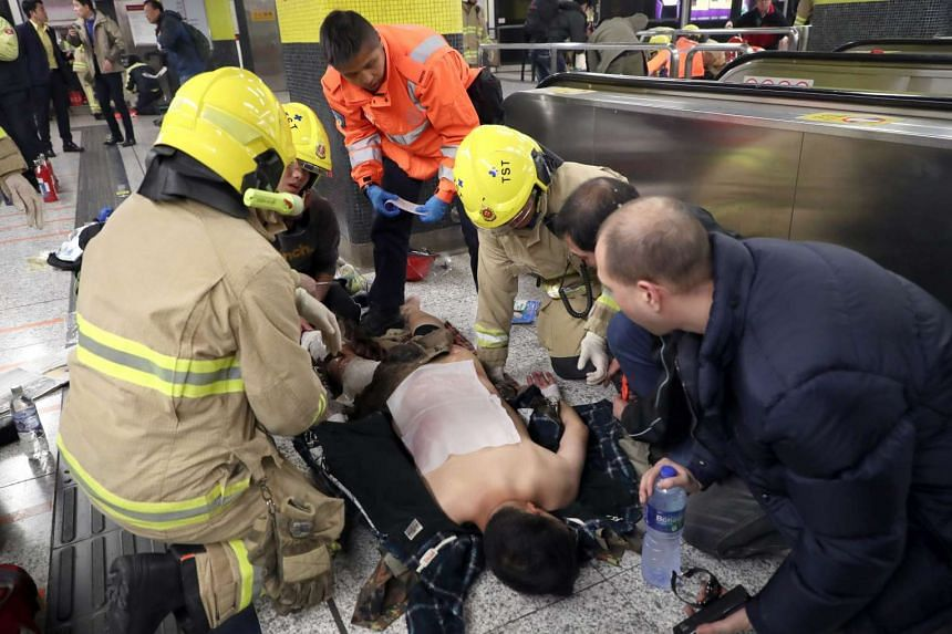 A passenger receiving medical assistance by Hong Kong rescue personnel after a fire broke out inside a subway train in Hong Kong on Feb 10, 2017.