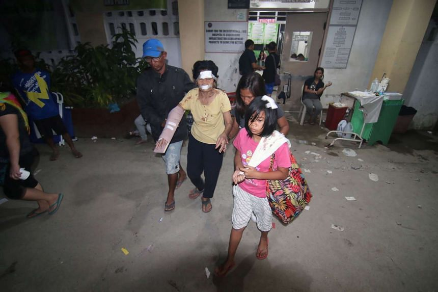 An injured woman with her family members at a hospital in Surigao City, southern island of Mindanao, on Feb 11, 2017.