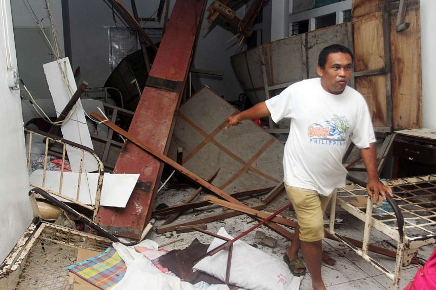 A man inspecting Caraga Regional hospital after an earthquake in Surigao city, southern Philippines, on Feb 10, 2017.
