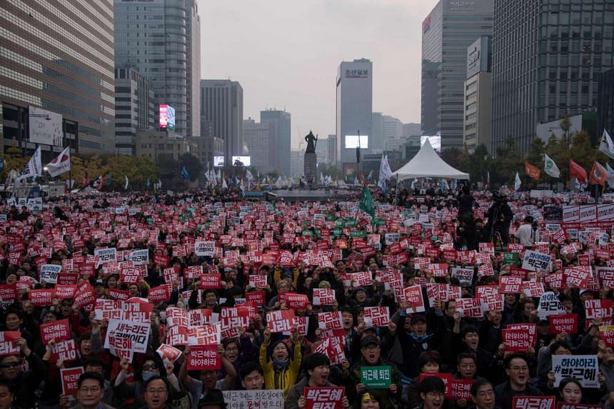 Demonstrators during a protest calling for the resignation of South Korean President Park Geun Hye in Gwanghwamun square in central Seoul on Nov 5, 2016.