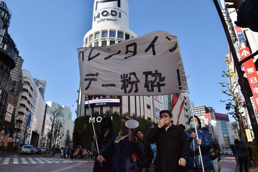 A group of Japanese protesters stage an anti-Valentine's Day demonstration march in Tokyo on Feb 12, 2017.