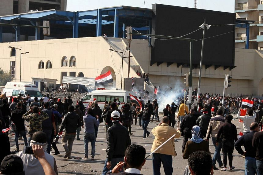 Supporters of Iraqi Shi'ite cleric Moqtada al-Sadr clash with Iraqi police forces following a demonstration at al-Tahrer square, central Baghdad on Feb 11, 2017.