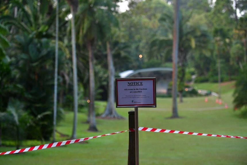A sign informing people of event cancellations are seen on the outskirts of the Symphony Lake at the Singapore Botanic Gardens on Feb 12, 2017.