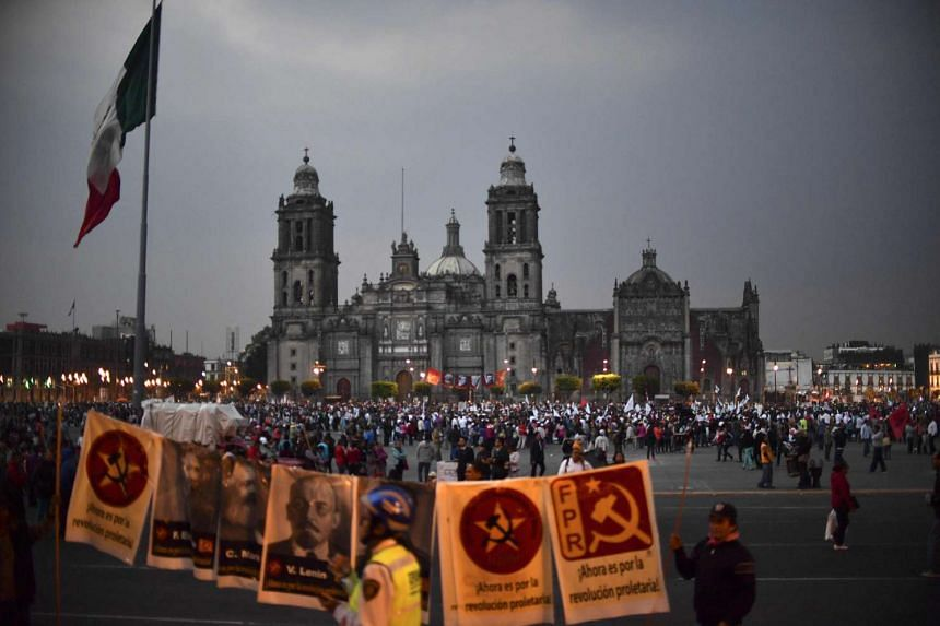 People gather at El Zocalo square during a protest against the increase in the price of gasoline and US President Donald Trump's plan of building a wall between Mexico and the US, in Mexico City on Jan 31, 2017.