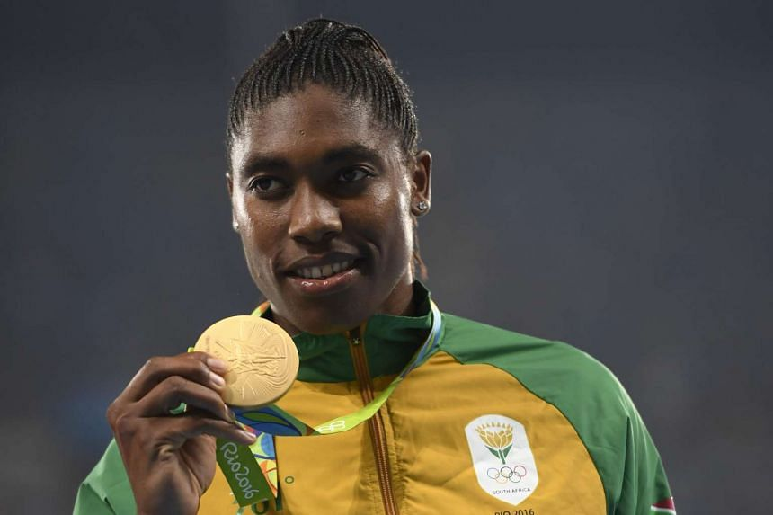 Caster Semenya poses with her gold medal after the women's 800m athletics final at the Rio 2016 Olympic Games on Aug 21, 2016.