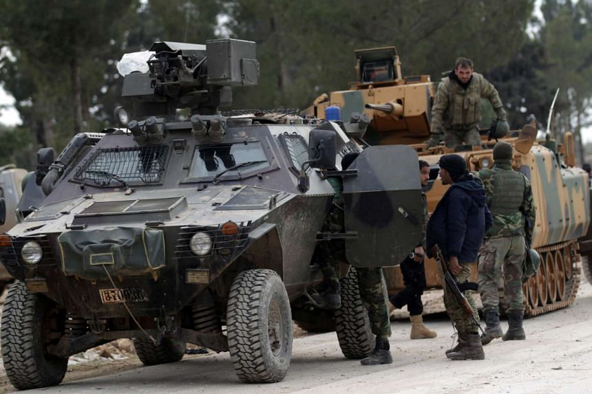 Turkish forces and members of the Free Syrian Army at the al Baza'a village on the outskirts of al-Bab town in Syria on Feb 4, 2017.