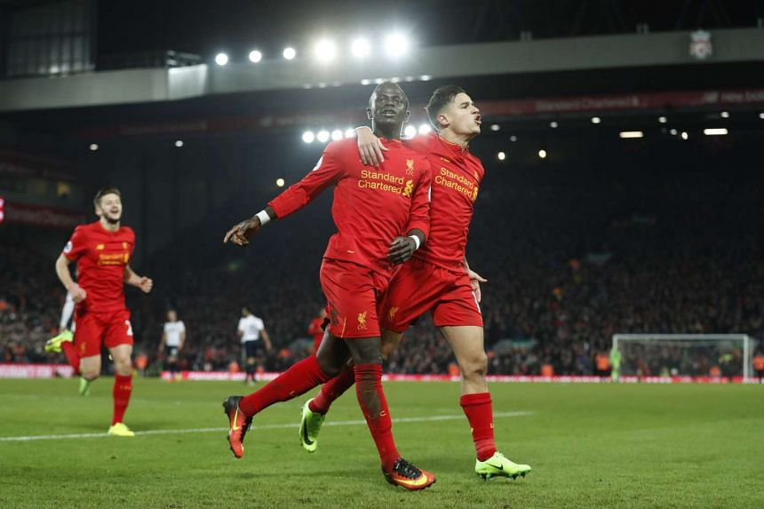 Liverpool's Sadio Mane celebrates scoring their second goal with Philippe Coutinho.