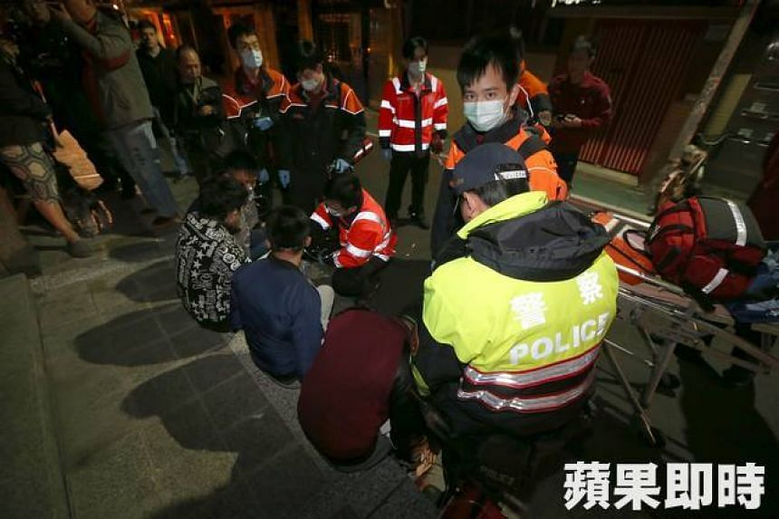 Rescue officers give oxygen treatment to the four tourists.