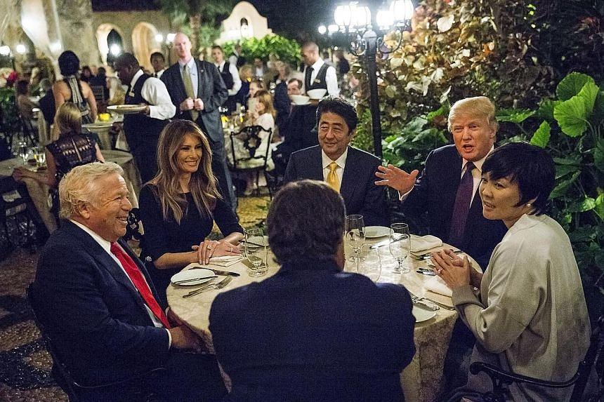 Mr Donald Trump dining with (from left) New England Patriots owner Robert Kraft, Mrs Melania Trump, Mr Shinzo Abe and Mrs Akie Abe at the Trumps' Mar-a-Lago retreat in Florida. Mrs Abe has used news interviews to make policy recommendations for her h