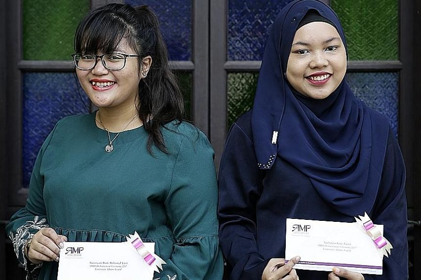 Ms Nurhaliza Ramli (left), and Ms Nursriwati Mohamed Yusri, both 19, were among the three recipients of the SMEF-Lt Adnan Award, which was given out for the first time yesterday. The award pays tribute to Lt Adnan Saidi (above) who had died defending