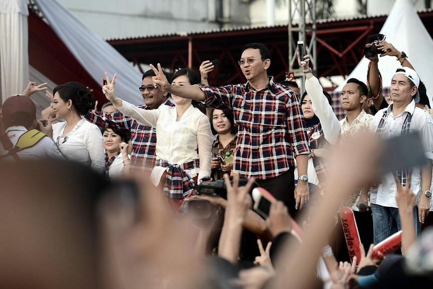 Chinese Christian governor Basuki Tjahaja Purnama (centre) gestures to his supporters at his final campaign rally prior to the gubernatorial election in Jakarta.