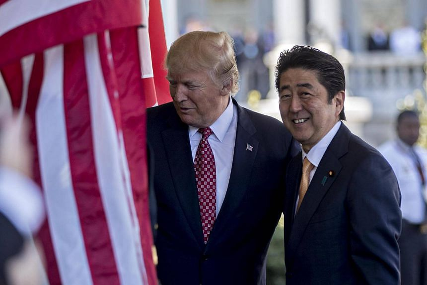 US President Donald Trump (left) and Japanese prime minister Shinzo Abe walking into the West Wing of the White House in Washington, DC, US, on Feb 10, 2017.