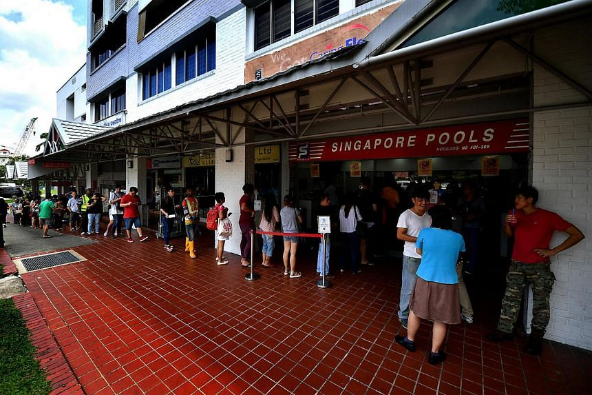 The queue at 211 Hougang Singapore Pools on Feb 10, 2017.