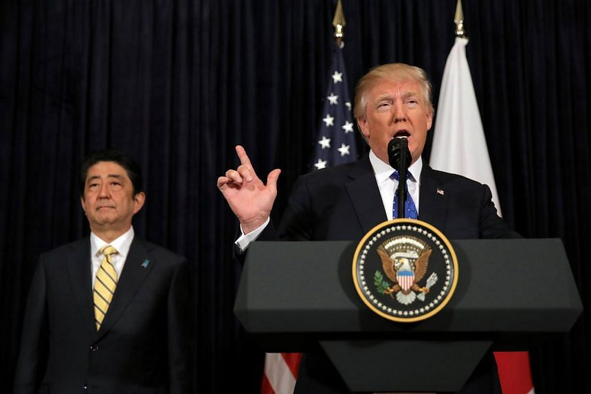 US President Donald Trump, accompanied by Japanese Prime Minister Shinzo Abe, delivers remarks on North Korea at Mar-a-Lago in Florida.