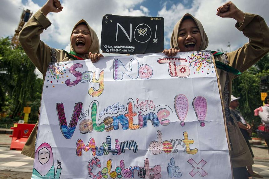 Girls from a local boarding school shout during an anti-Valentine's Day rally in Surabaya, East Java province on Feb 13, 2017.