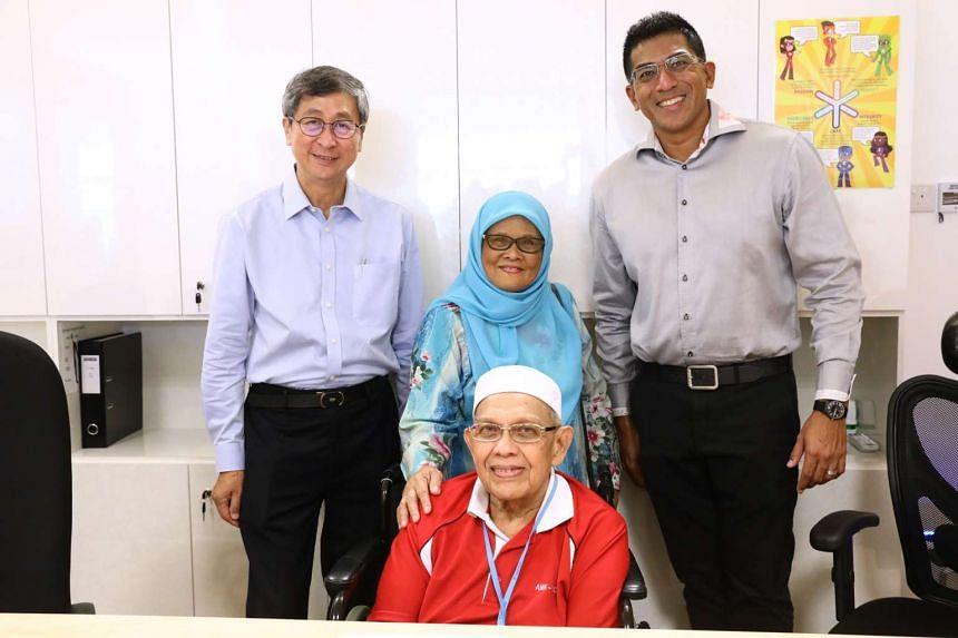 Mr Karim Idris Abdullah (front, centre) accompanied by (from left) NTUC chairman Lim Boon Heng, Mr Karim's wife Hajjah Tuharah and Ang Mo Kio MP Darryl David at the Ci Yuan Silver Circle Senior Care Centre.