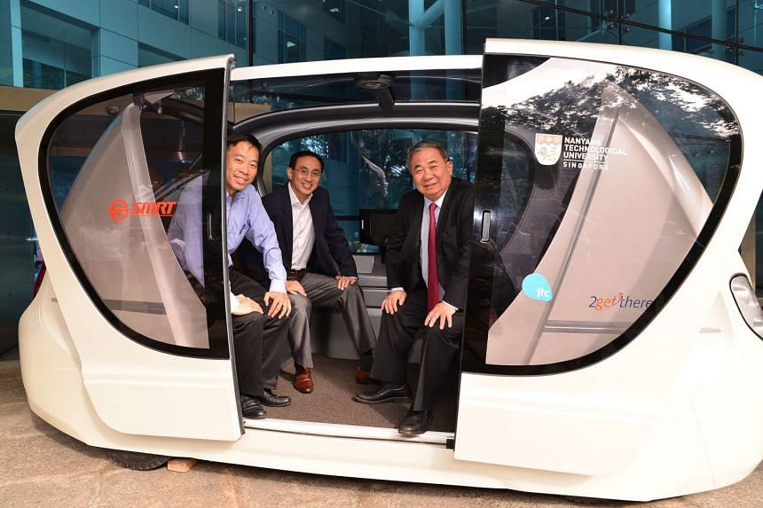 (From left) JTC CEO Png Cheong Boon, SMRT President and Group CEO Desmond Kuek, and NTU Provost Professor Freddy Boey inside a driverless Personal Rapid Transit vehicle.