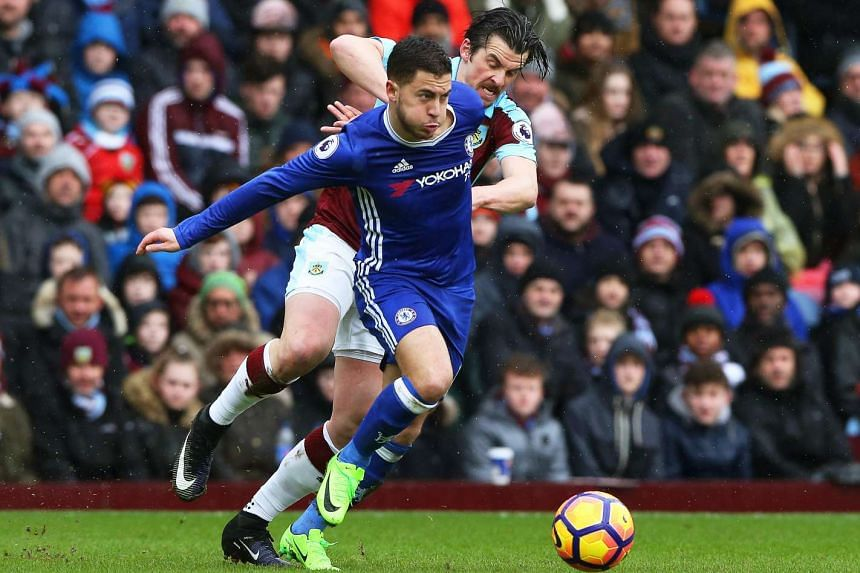 Burnley's Joey Barton (right) in action against Chelsea's Eden Hazard (left) during the English Premier League soccer match between Burnley FC and Chelsea FC at Turf Moor Stadium in Burnley, Britain, on Feb 12, 2017.