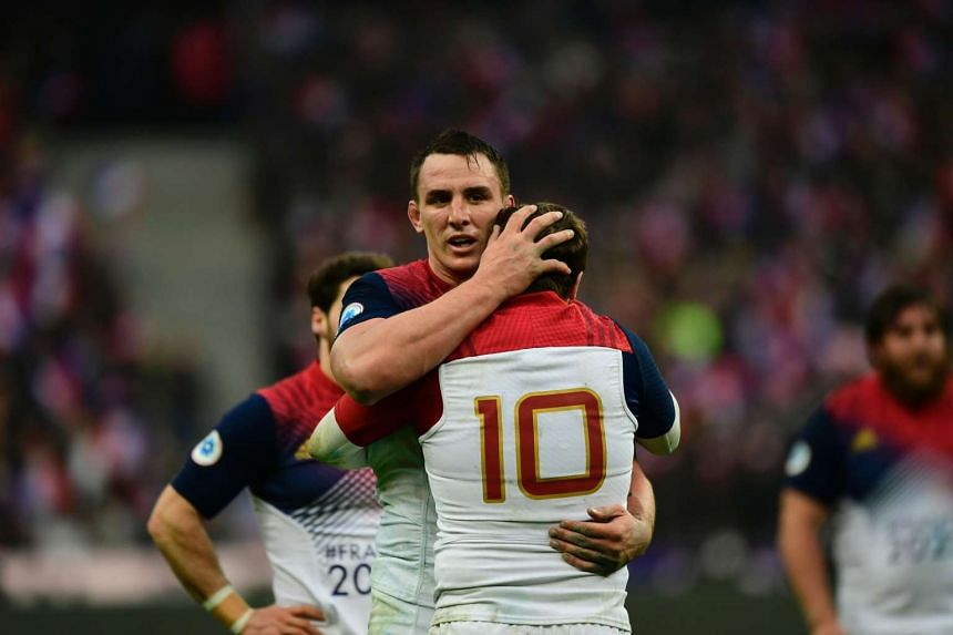 France's flanker Louis Picamoles (left) celebrates with his teammate France's fly half Camile Lopez after winning the Six Nations international rugby union match in Saint-Denis, on Feb 12, 2017.