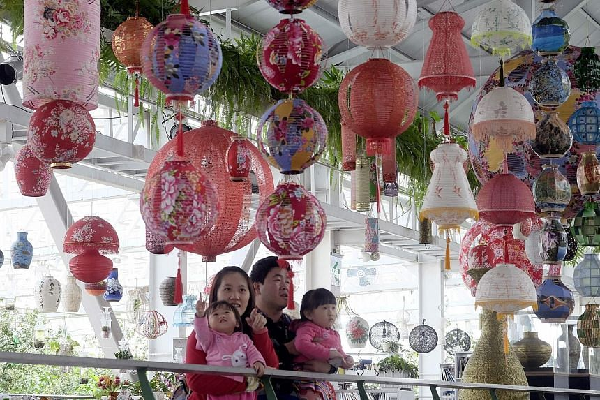 Above: Eco-friendly lanterns made by artist Lin Chow-chin go on display in Yilan, eastern Taiwan, for the annual lantern festival. Left: Mr Lin showing how his lanterns can be recycled as a vase, by replacing the bulb with a water bottle.