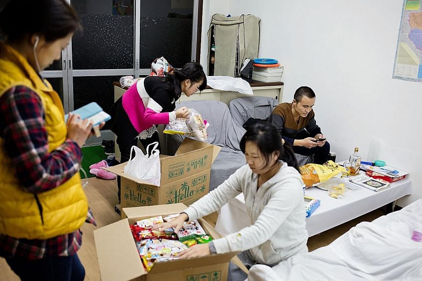 """A dormitory for """"technical trainees"""" who have lost their housing along with their jobs, at a labour union office in Hashima. Japan's foreign-born labour force recently topped one million people, many of them on visas reserved for technical trainees,"""
