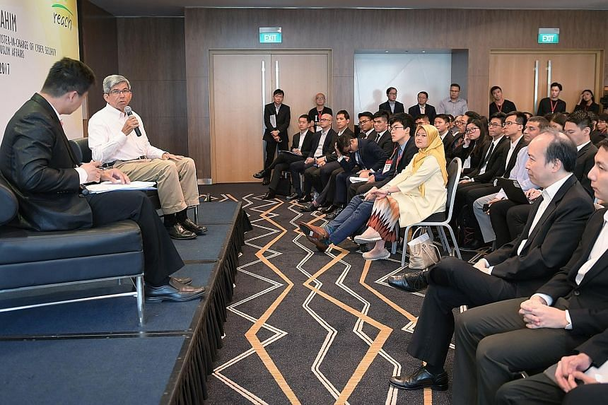 Dr Yaacob speaking at the dialogue with tertiary students yesterday, held as part of an inaugural Singapore Model Cabinet event. With him was moderator Charles Phua, president of the Association of Public Affairs at the Lee Kuan Yew School of Public