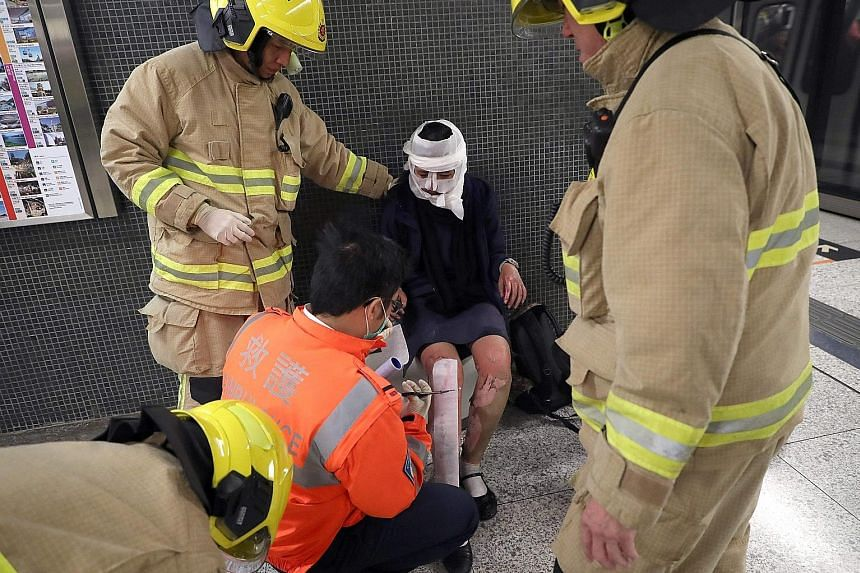 A passenger receiving medical assistance from Hong Kong rescue personnel. Reports said a man hurled a lit Molotov cocktail on board the packed train. The damaged train as it was about to pull up at the platform of Tsim Sha Tsui station. Safety fears