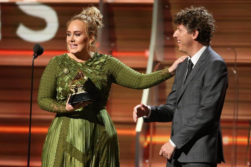 Adele and co-song writer Greg Kurstin accepting the Grammy for Song of the Year for Hello at the 59th Annual Grammy Awards in Los Angeles, California, US, on Feb 12, 2017.